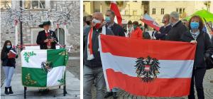 Meinrad Berger bei seiner Ansprache und Kundgebungsteilnehmer in Trient mit der österreichischen Staatsflagge